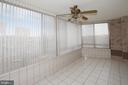 Expansive sunroom with ceiling fan - 19375 CYPRESS RIDGE TER #107, LEESBURG