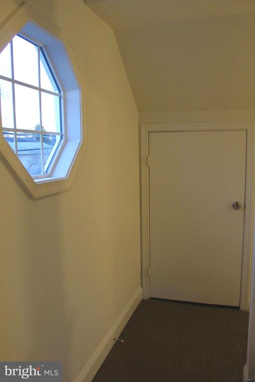 Top of the staircase to the hallway with storage - 175 MANASSAS DR, MANASSAS PARK
