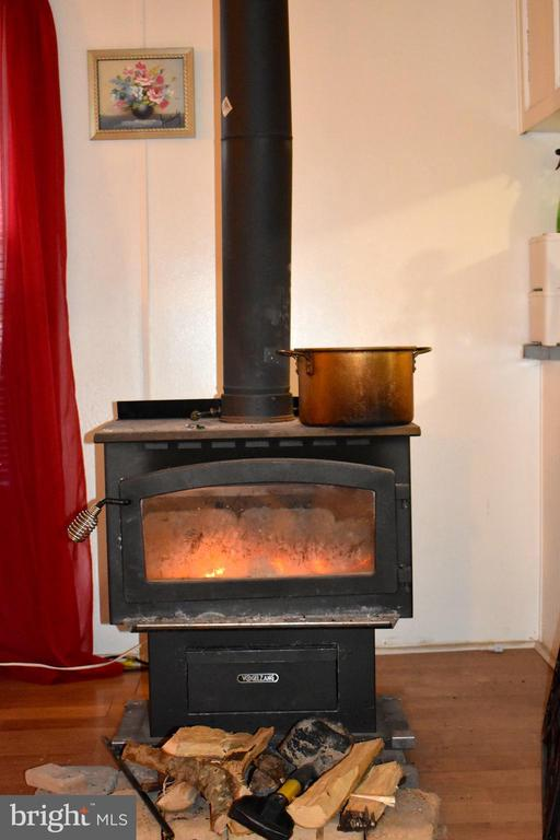 Wood Stove Located Between Kitchen And Dining Room - 34296 INDIANTOWN RD, LOCUST GROVE
