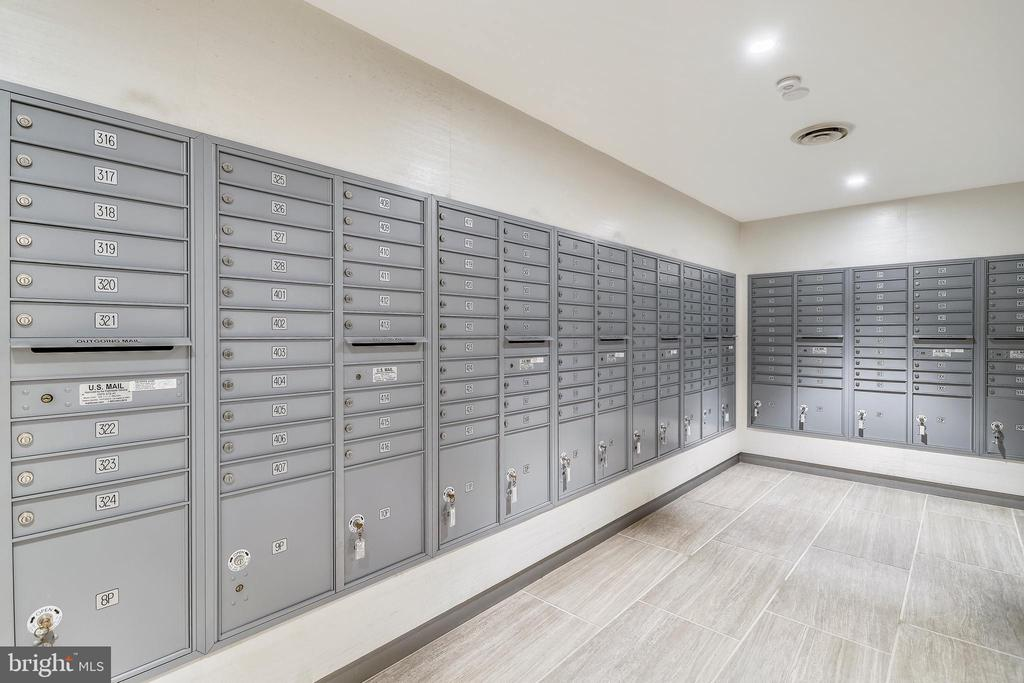 Mail Room with secured boxes for packages. - 4141 N HENDERSON RD #1011, ARLINGTON