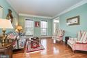 Formal living room with hardwood floor - 5947 TUMBLE CREEK CT, HAYMARKET