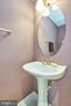 Main level powder room with pedastal sink - 5947 TUMBLE CREEK CT, HAYMARKET