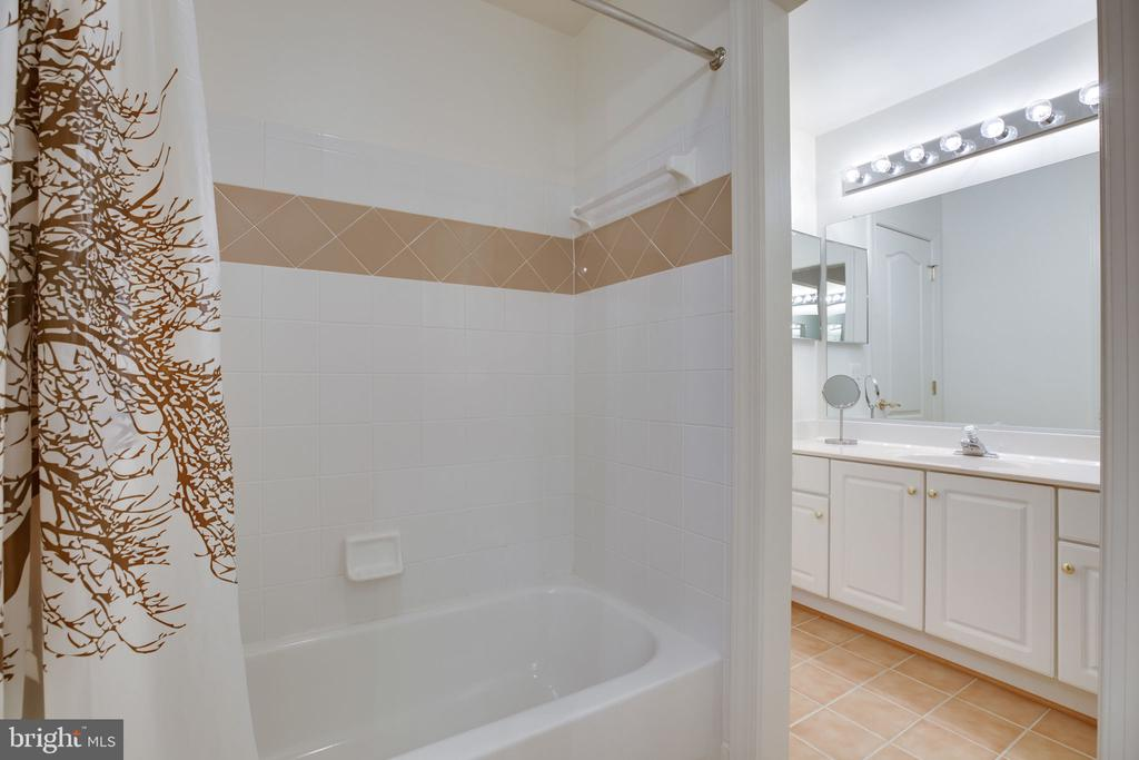 Tub/Shower of  shared bath - 12110 WALNUT BRANCH RD, RESTON