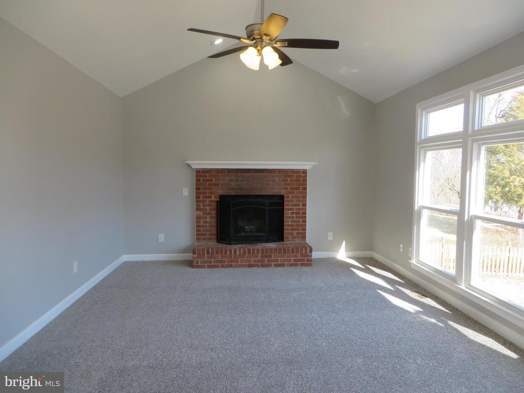 FAMILY ROOM WITH BRICK WOOD BURNING FIREPLACE - 43 JASON LN, STAFFORD