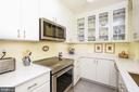 Gourmet kitchen with quartz counters, SS appliance - 3900 WATSON PL NW #A-2FG, WASHINGTON