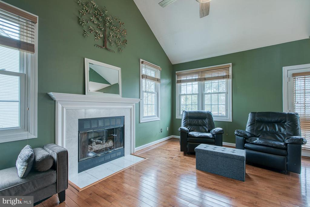Two-story living room with gas fireplace - 43976 BRUCETON MILLS CIR, ASHBURN