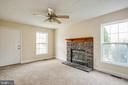 Family room with wood burning fireplace - 7517 MATTAPONI, KING GEORGE