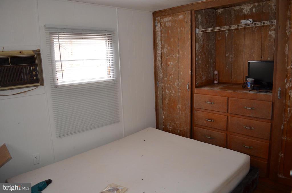 Bedroom 2 - Disclosure - Mold on wooden built-ins - 5420 BURKITTSVILLE RD, JEFFERSON