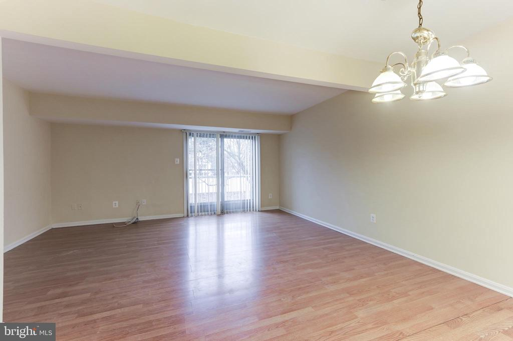 Large Living/Dining Space w/ Access to Balcony - 6125 STRASBURG DR, CENTREVILLE