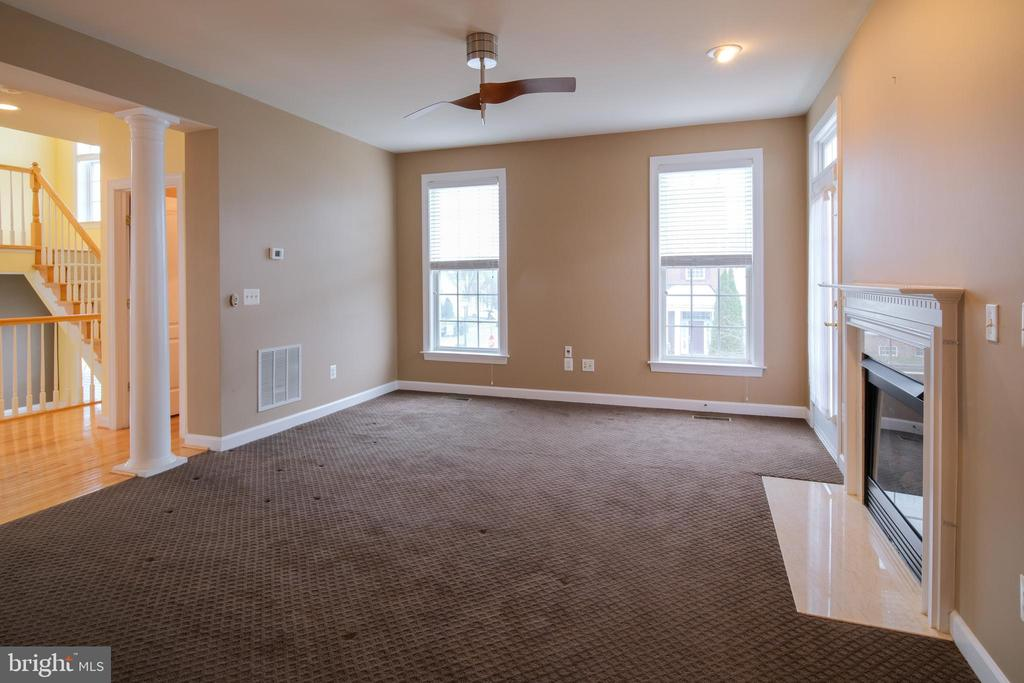 Family room with access to patio - 13299 SCOTCH RUN CT, CENTREVILLE