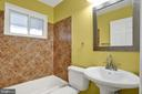 Renovated bath with tiled bathtub - 6601 SEAT PLEASANT DR, CAPITOL HEIGHTS