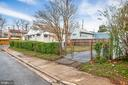 Fenced backyard with a gravel driveway - 6601 SEAT PLEASANT DR, CAPITOL HEIGHTS