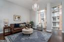 SPACIOUS LIVING ROOM WITH FLOOR TO CEILING WINDOWS - 12025 NEW DOMINION PKWY #504, RESTON