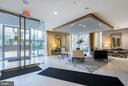 SECURE LOBBY OF THE BUILDING WITH CONCIERGE DESK - 12025 NEW DOMINION PKWY #504, RESTON