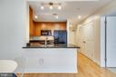 Kitchen opens  to living and dining areas - 4101 ALBEMARLE ST NW #447, WASHINGTON