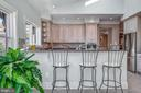 Kitchen, Breakfast Bar and Skylights - 1128 ASQUITH DR, ARNOLD