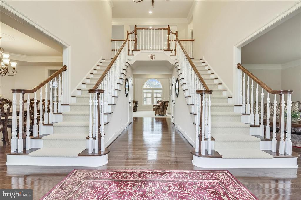Grand foyer with elegant dual staircase - 44306 KENTMERE CT, ASHBURN