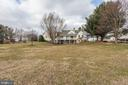 Exterior view from backyard to the home - 2407 FLAG MARSH RD, MOUNT AIRY