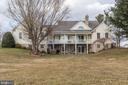 View of the back of the home - 2407 FLAG MARSH RD, MOUNT AIRY