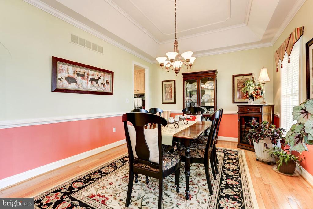 Dining area has tray ceiling - 2407 FLAG MARSH RD, MOUNT AIRY