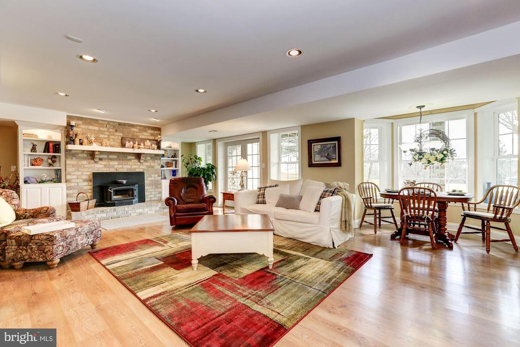 Lower level living area with fireplace - 2407 FLAG MARSH RD, MOUNT AIRY
