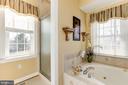 Main level owner's bathroom separate shower - 2407 FLAG MARSH RD, MOUNT AIRY