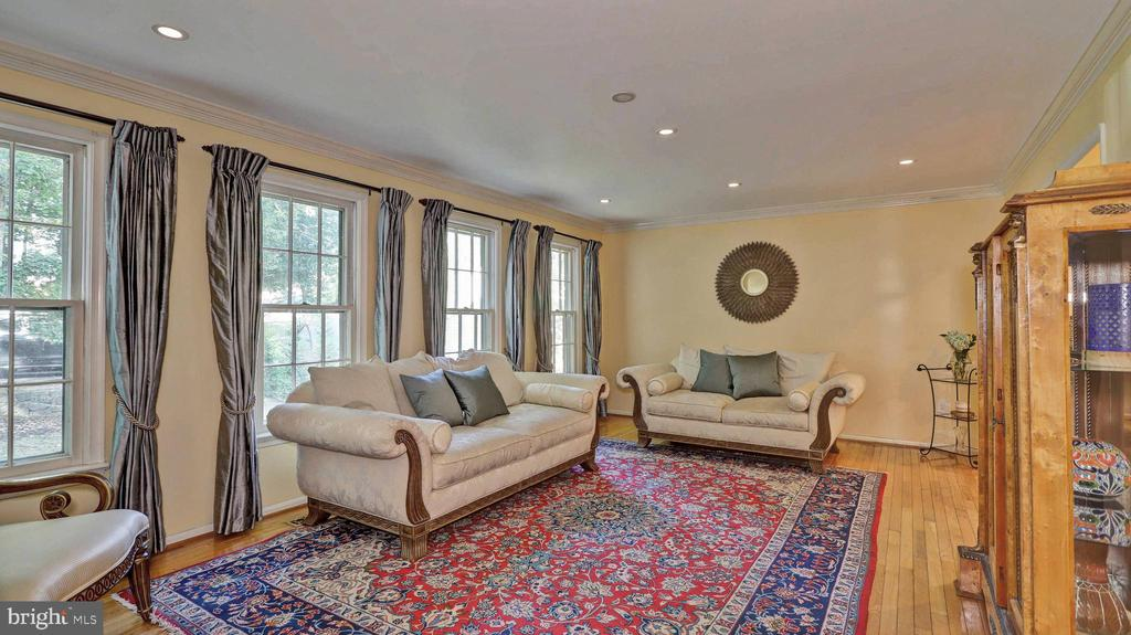 Living room with four large windows... - 7504 GLENNON DR, BETHESDA