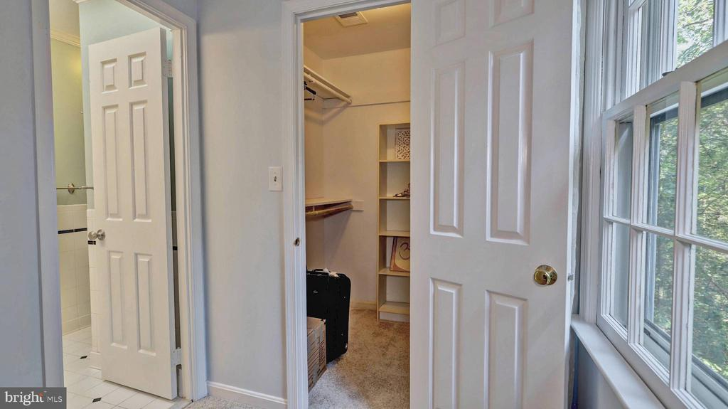 One of two master suite walk-in closets... - 7504 GLENNON DR, BETHESDA