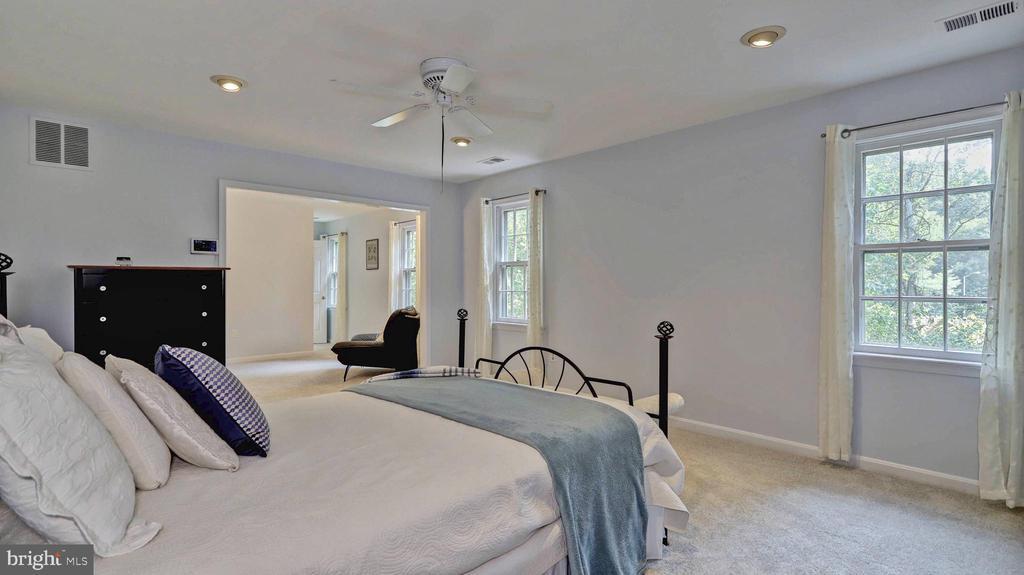 Master bedroom with recessed lightning... - 7504 GLENNON DR, BETHESDA