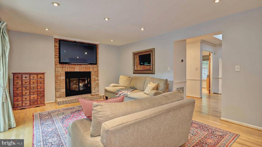 Family room fireplace... - 7504 GLENNON DR, BETHESDA