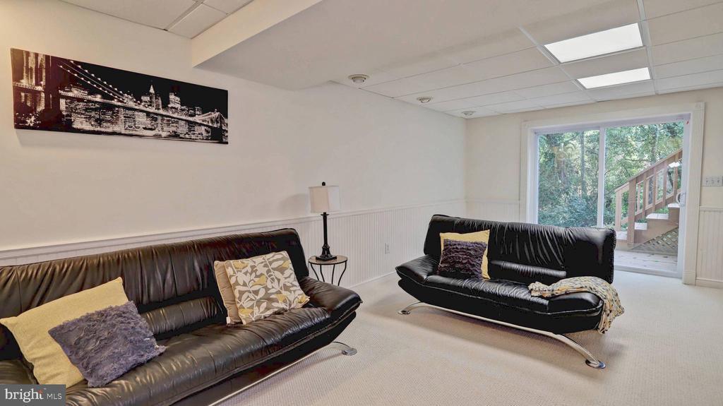 Recreation room with new sliding doors... - 7504 GLENNON DR, BETHESDA