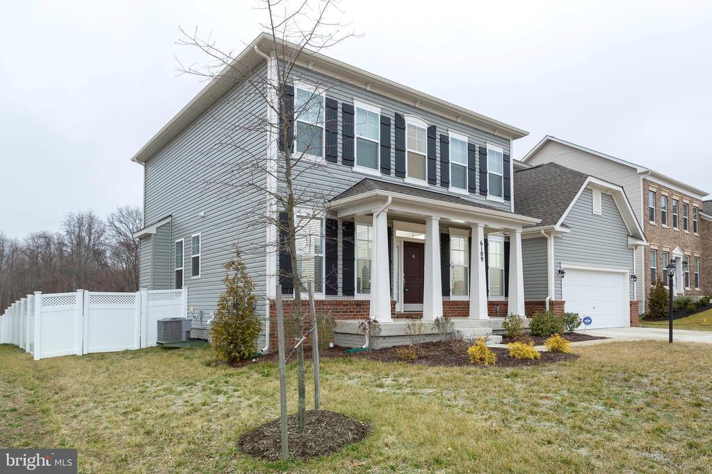 Left Side View of Home - 6109 HUNT WEBER DR, CLINTON
