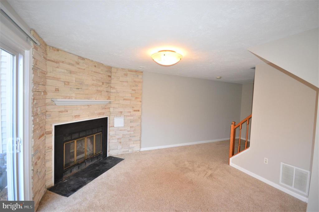 Cozy nights in front of the fire. - 6490 BRICK HEARTH CT, ALEXANDRIA