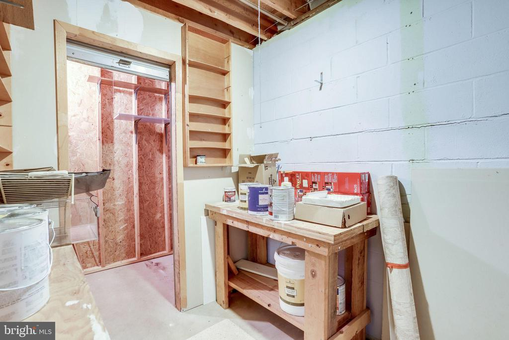 Tool room with safe area. - 9211 ANTELOPE PL, SPRINGFIELD