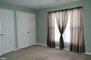 Light filled Bedroom with a large closet. - 134 BRADDOCK ST, CHARLES TOWN