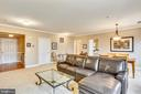 Living room (w/ foyer entrance & door to Laundry) - 802 GRAND CHAMPION DR #11-302, ROCKVILLE