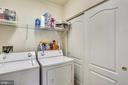 Laundry Room with Utility Closet (off Living Room) - 802 GRAND CHAMPION DR #11-302, ROCKVILLE