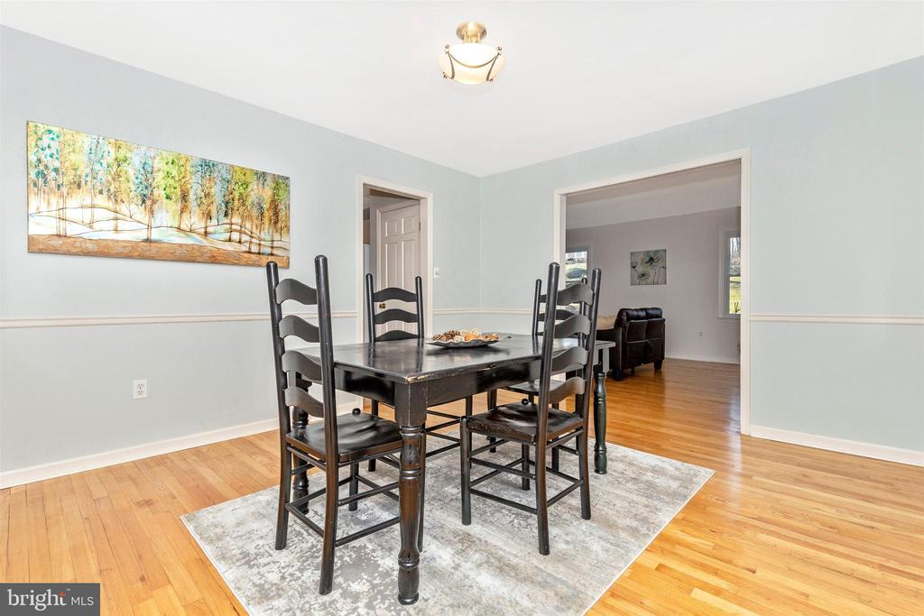 Dining room with hardwood flooring - 5800 MEADOW DR, FREDERICK