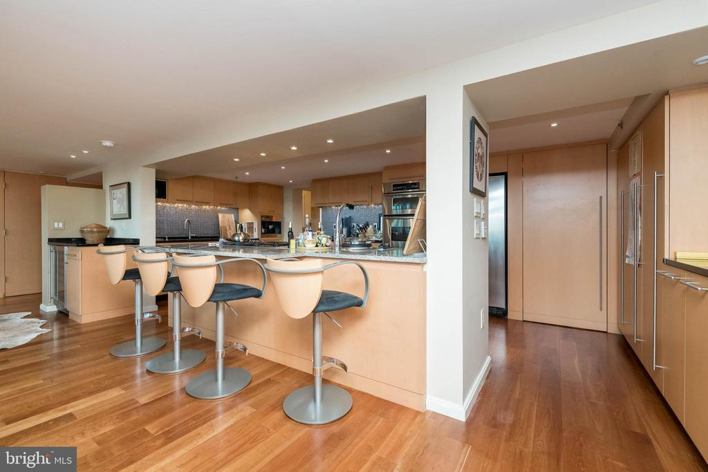 Large Kitchen island with seating. - 2901 BOSTON ST #214, BALTIMORE