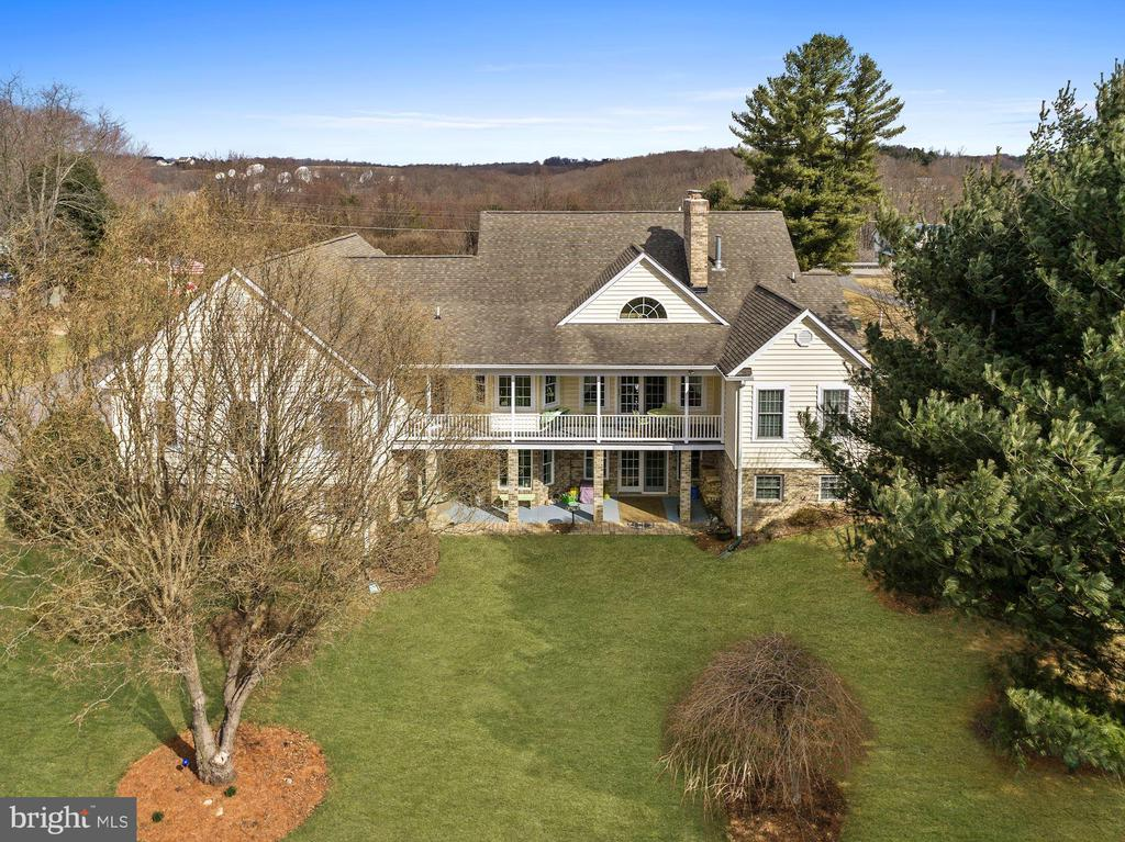 View of the home from the backyard - 2407 FLAG MARSH RD, MOUNT AIRY
