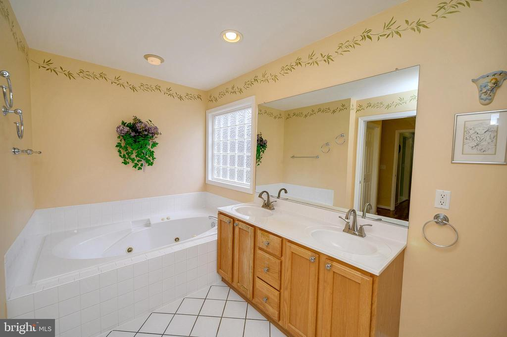 Wash the day away in this large soaking tub. - 509 MT PLEASANT DR, LOCUST GROVE