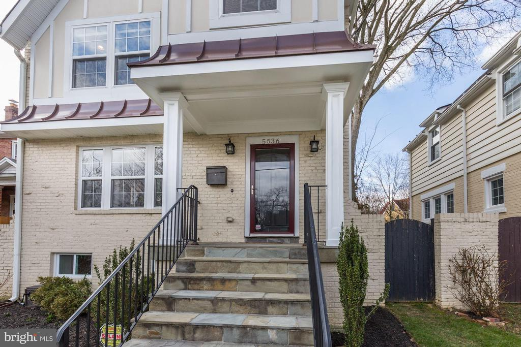 Expanded and renovated; top to bottom - 5536 30TH PL NW, WASHINGTON
