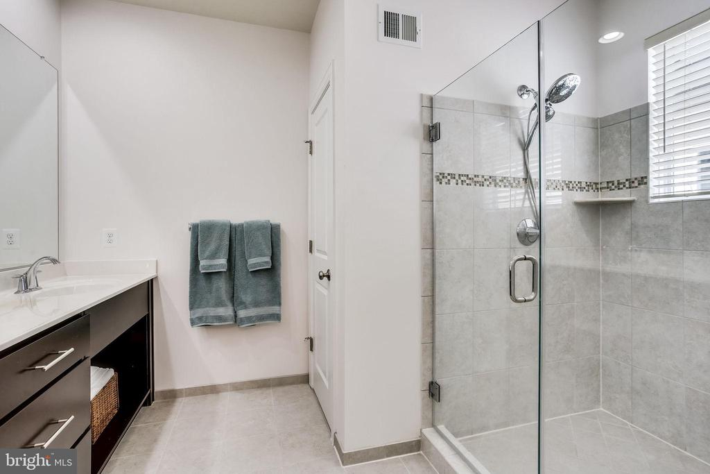 With dual vanity and spacious glass shower - 44536 STEPNEY DR, ASHBURN