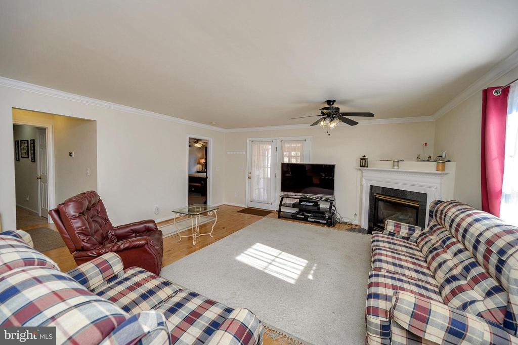 Cozy up to the corner gas fireplace. - 200 SAND TRAP LN, LOCUST GROVE