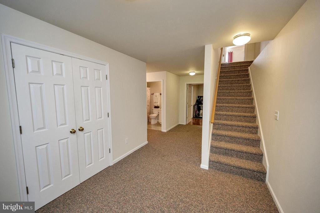 The double doors are to your laundry room. - 200 SAND TRAP LN, LOCUST GROVE