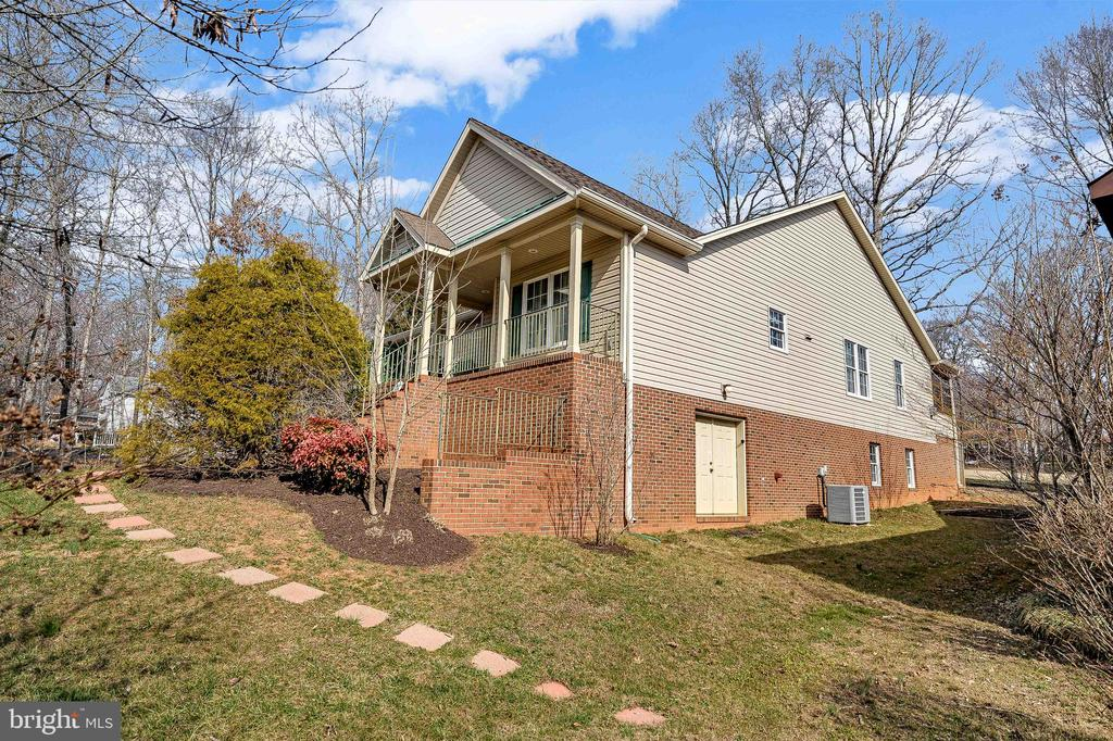 Beautifully Landscaped!  Basement outdoor entry. - 200 SAND TRAP LN, LOCUST GROVE
