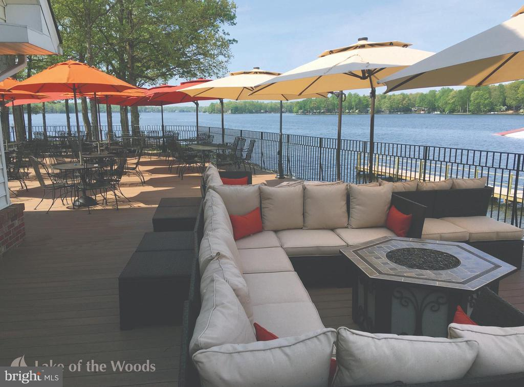 Deck and fire pit over looking the lake. - 200 SAND TRAP LN, LOCUST GROVE