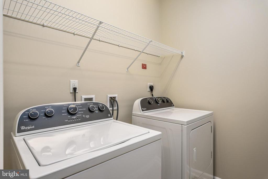 Laundry with shelving for storage - 20570 HOPE SPRING TER #206, ASHBURN