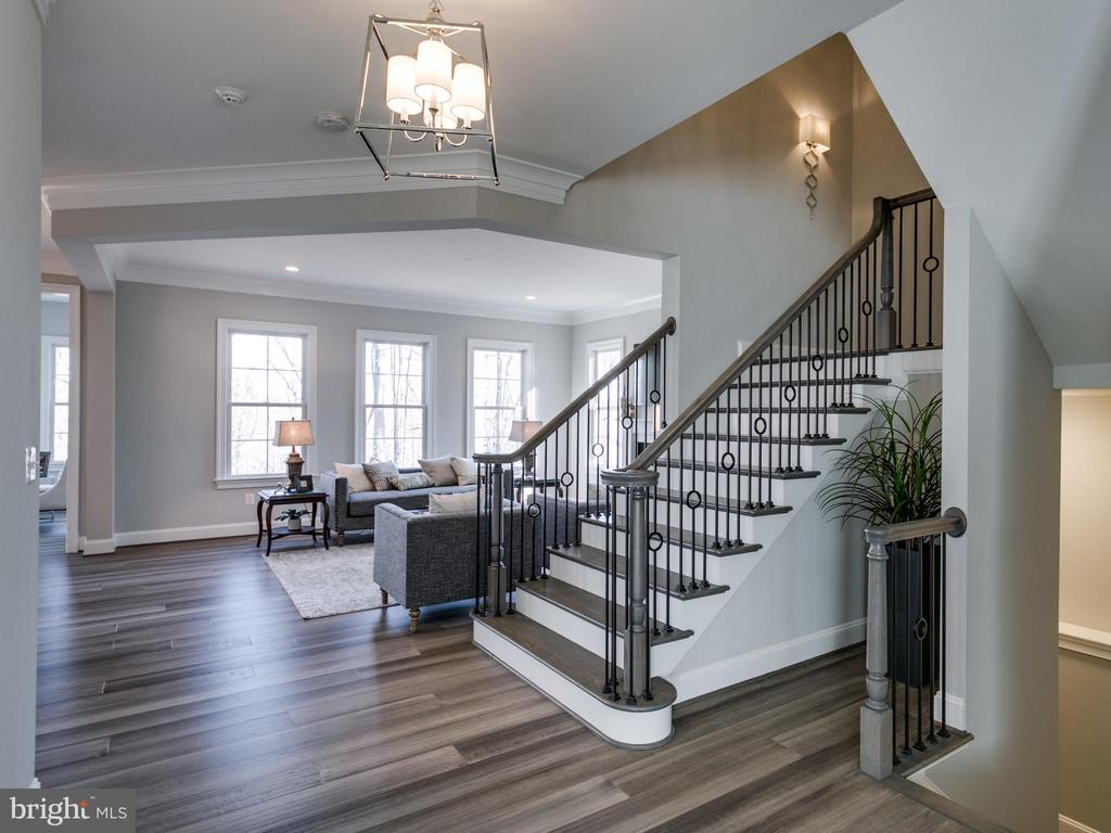 Intricate wrought iron detailed staircase - 9978 BLACKBERRY LN, GREAT FALLS