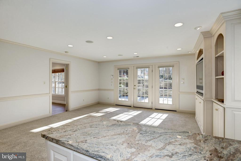 French doors open to stone patio with hot tub - 3818 N RANDOLPH CT, ARLINGTON